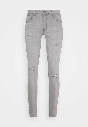 STOCKHOLM DESTROY - Jeansy Skinny Fit - bleach grey