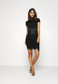 Guess - REGINA SKIRT - Pencil skirt - jet black - 1