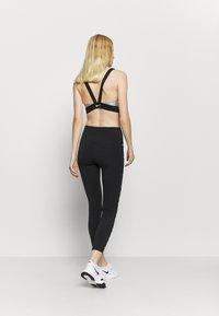 Nike Performance - ONE TAPING - Leggings - black/white - 2