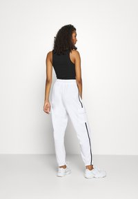 Missguided - CONTRAST PIPING - Tracksuit bottoms - white - 2