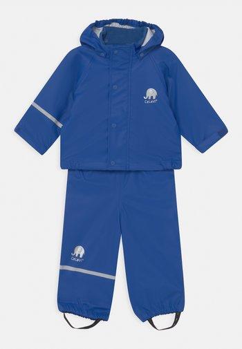 BASIC RAINWEAR SOLID SET UNISEX - Waterproof jacket - ocean blue