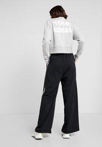 adidas Performance - WIDE PANT - Träningsbyxor - black - 2