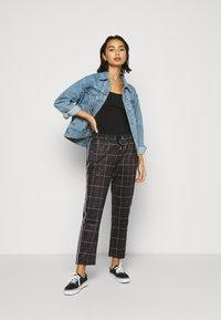 Fila Petite - WINTA CROPPED PANTS - Trousers - black - 1