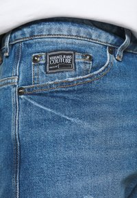 Versace Jeans Couture - DRILL - Slim fit jeans - light-blue denim - 6