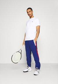 Lacoste Sport - TRACKSUIT BOTTOMS - Pantaloni sportivi - blue - 1