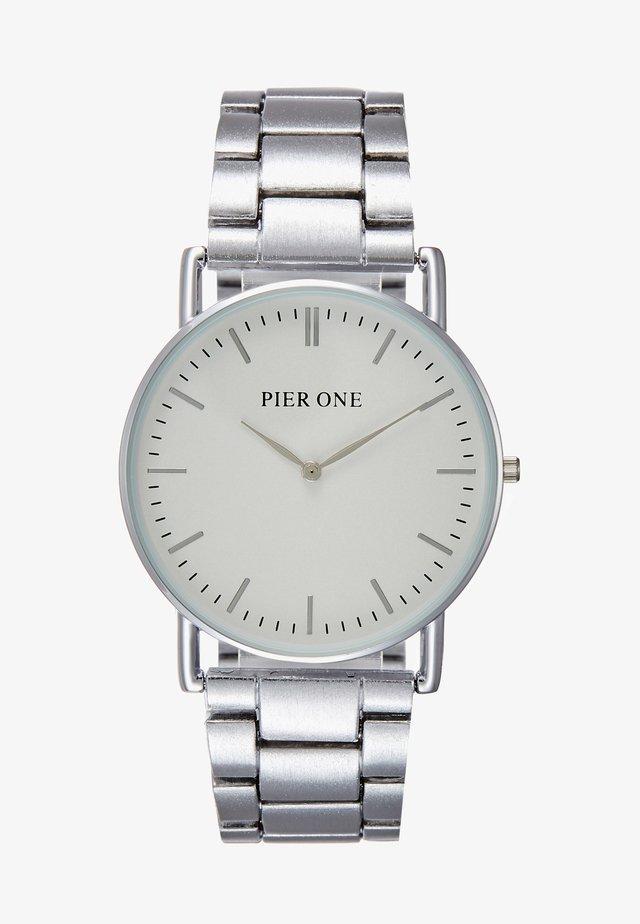 Klokke - white/silver-coloured