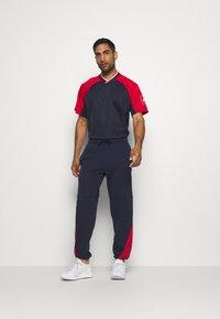 adidas Performance - Pantalon de survêtement - dark blue - 1