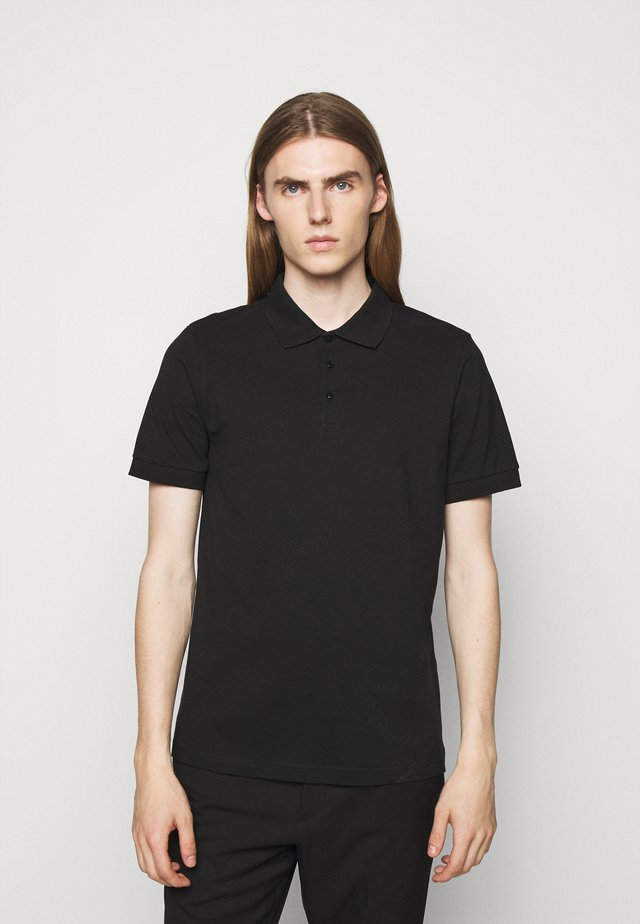 RAUL GONZALES - Polo shirt - black