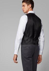 BOSS - GENIUS5 - Suit trousers - dark grey - 3