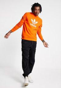 adidas Originals - TREFOIL CREW UNISEX - Sweatshirt - orange - 1