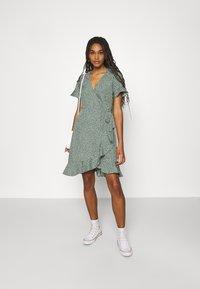 Vero Moda - VMHENNA WRAP FRILL DRESS - Korte jurk - laurel wreath - 1