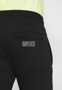 The Couture Club - ESSENTIALS - Tracksuit bottoms - black - 3