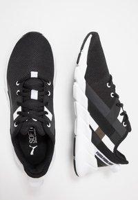Puma - WEAVE XT - Stabilty running shoes - black/white - 1