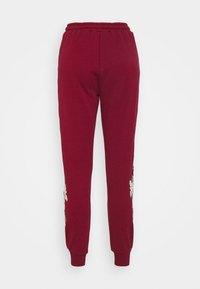 SIKSILK - FLORAL EMBROIDERED JOGGERS - Tracksuit bottoms - burgundy - 7