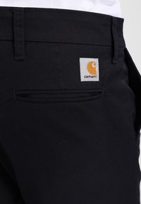 Carhartt WIP - SID LAMAR - Pantalones chinos - dark navy rinsed - 4