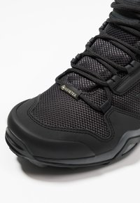 adidas Performance - TERREX AX3 MID GORE-TEX - Hiking shoes - carbon/core black/active pink - 5