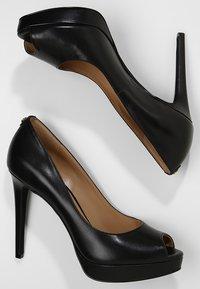 MICHAEL Michael Kors - ERIKA PLATFORM - Peeptoe heels - black - 3