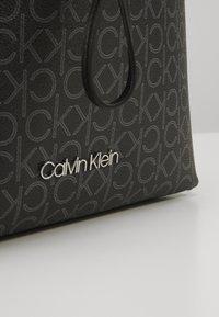 Calvin Klein - DRAWSTRING BUCKET BAG MONOGRAM - Sac bandoulière - black - 2