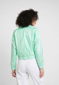 Puma - EVIDE JACKET - Waterproof jacket - mist green - 2