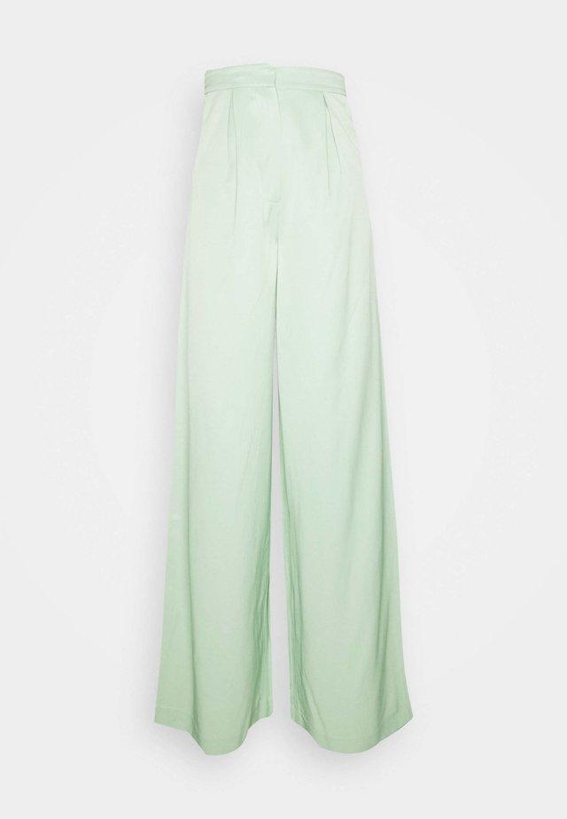 HOSS X NA-KD WIDE LEG PANTS - Pantaloni - pastel green