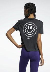 Reebok - T-shirt con stampa - black - 2