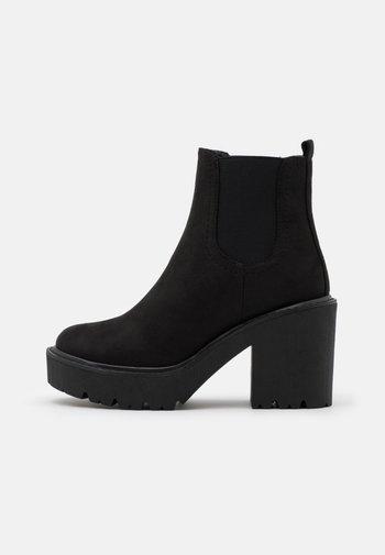 BLITZ CHELSEA UNIT BOOT - Kotníkové boty na platformě - black