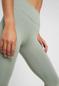 Nike Performance - NIKE ONE TIGHT CAPRI - Leggings - jade stone/black - 3