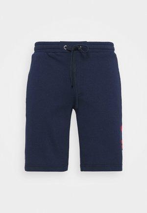 ROBERT - Pantalón corto de deporte - peacoat blue