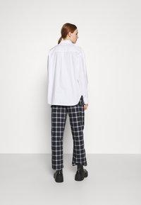 Monki - MEJA FANCY SHIRT - Button-down blouse - white solid - 2