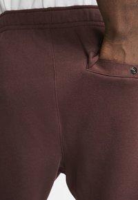 Nike Sportswear - CLUB - Tracksuit bottoms - bordeaux - 5