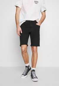 Levi's® - TAPER - Denim shorts - eight ball - 0
