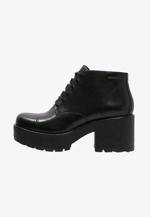 DIOON - Kotníkové boty na platformě - black