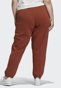 adidas Originals - CUFFED JOGGERS - Tracksuit bottoms - brown - 1