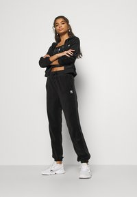 adidas Originals - JOGGER - Tracksuit bottoms - black - 1