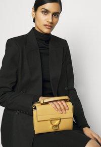 Coccinelle - ARLETTIS - Handbag - warm beige - 1