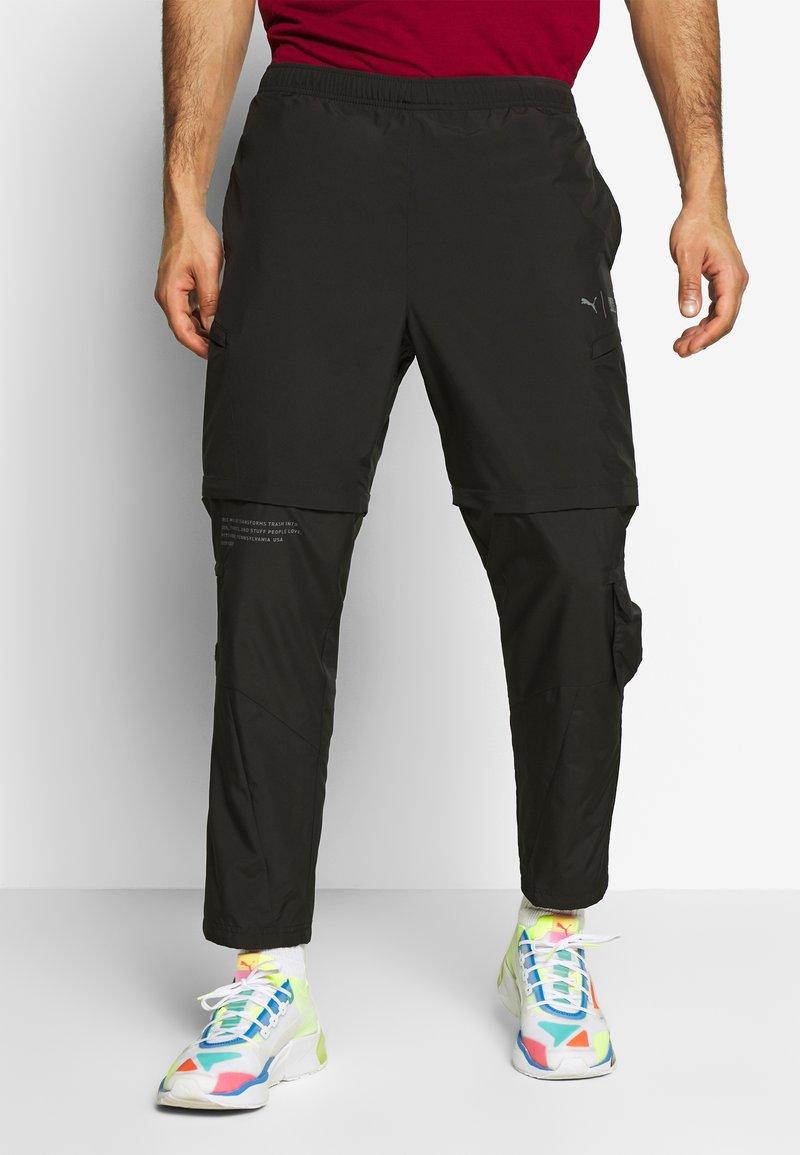 Puma - FIRST MILE 2IN1 PANT - Jogginghose - black