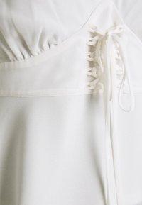 NA-KD - LACING DETAIL SINGLET - Blusa - white - 2