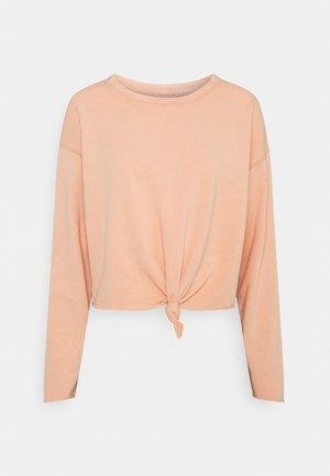 KNOT TIE CROP - Long sleeved top - peach cargo