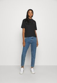 Gina Tricot - DAGNY HIGHWAIST - Jeans Tapered Fit - mid blue - 1