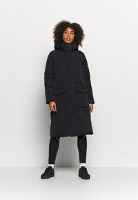 Champion - HOODED JACKET ROCHESTER - Winter coat - black - 0