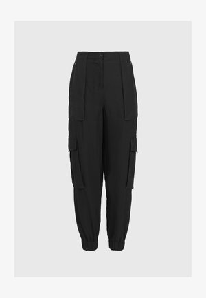 FRIEDA - Trousers - black