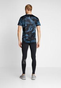 New Balance - PRINTED ACCELERATE - Tights - black - 2