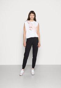 Nike Sportswear - TIGHT - Pantalon de survêtement - black/white - 1