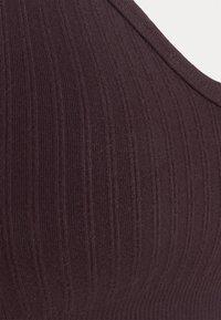Sweaty Betty - MINDFUL SEAMLESS YOGA BRA - Light support sports bra - black cherry purple - 5