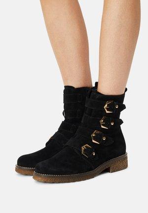 Korte laarzen - schwarz/gold