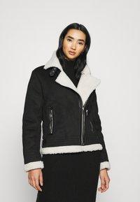 ONLY - ONLDIANA BONDED AVIATOR JACKET - Faux leather jacket - black/white - 0