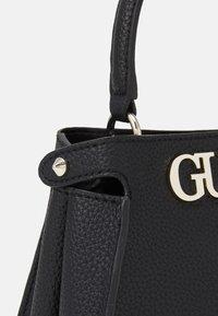 Guess - UPTOWN CHIC SATCHEL - Handbag - black - 3
