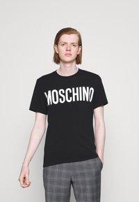 MOSCHINO - Print T-shirt - black - 0