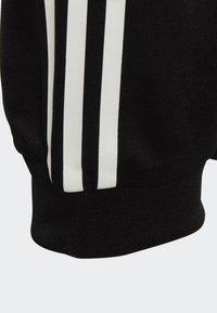 adidas Originals - FLAMESTRIKE TRACKSUIT BOTTOMS - Tracksuit bottoms - black - 2
