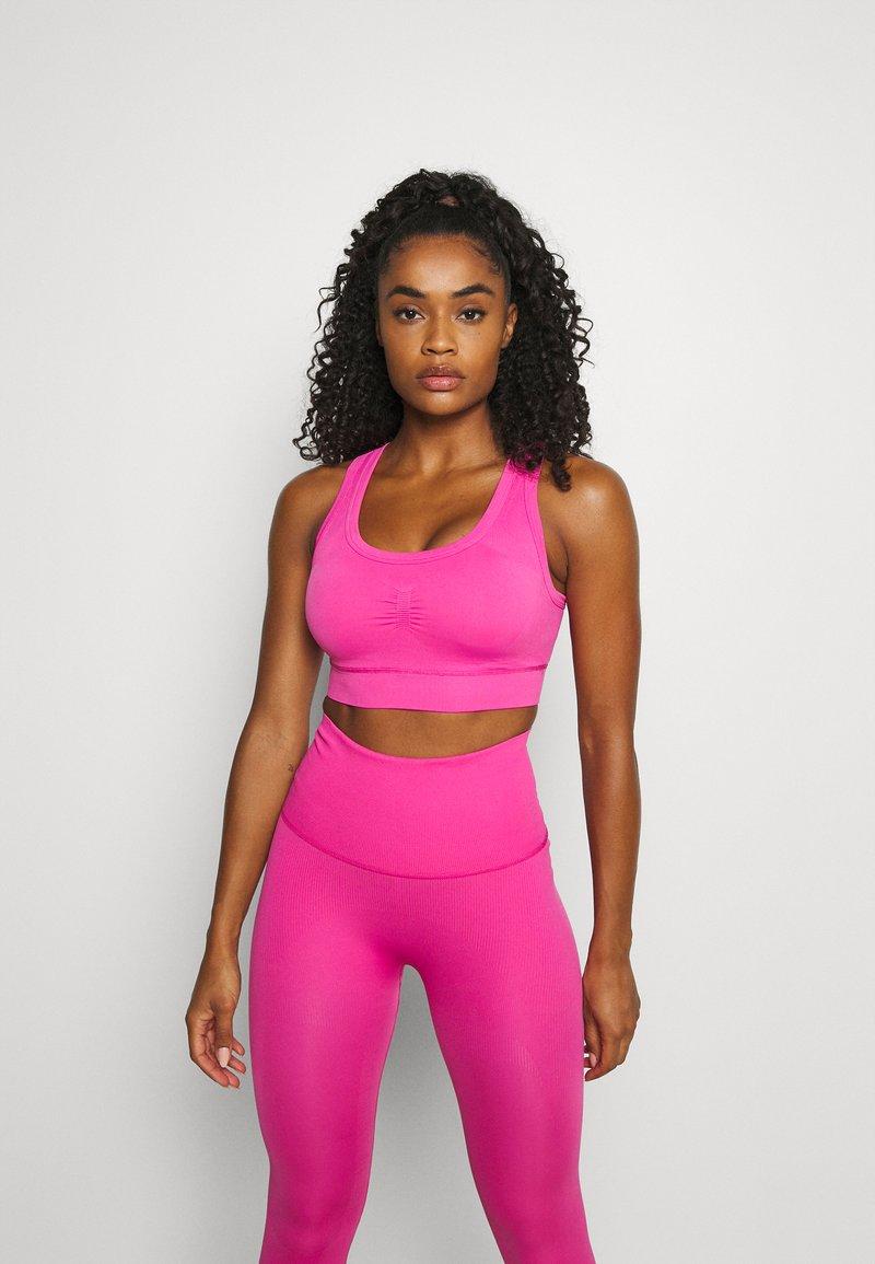 adidas Performance - DESIGNED4TRAINING FORMOTION COMPRESSION - Medium support sports bra - screaming pink